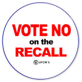 """Round button that says """"Vote no on the recall"""""""